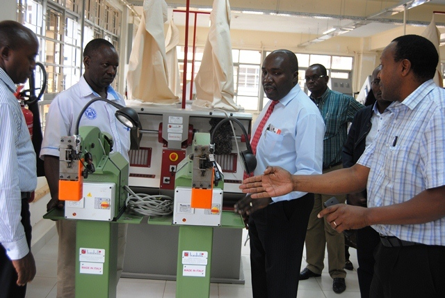 ps Julius Korir inspects shoe making machines at the Kenya Industrial Research and Development Institute in Kisumu1
