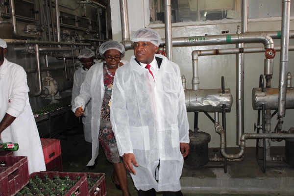 Industrialization & Enterprise Development PS Dr. Wilson Songa is shown wine production processes when he visited the KWAL factory on March 28, 2014